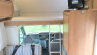 Rimor 6 Berth campervan interior front bunk and storage