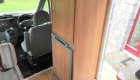 Rimor 6 Berth campervan interior front storage and fridge