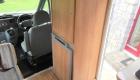 Rimor 6 Berth campervan interior front storage and fridge